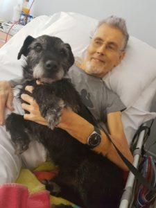 Trevor and his dog in the Inpatient Unit