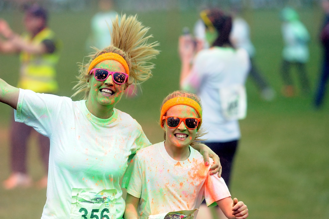 People running in coloured paint